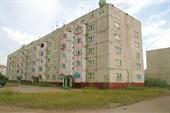 Одна из типовых пятиэтажек Чары, построенных казахами