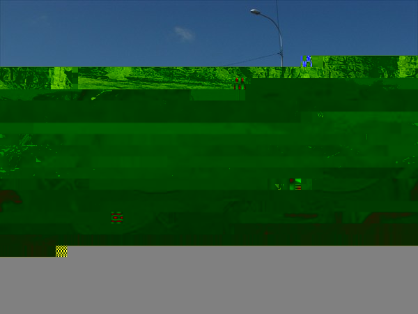 Памятник из сожжённых автомобилей