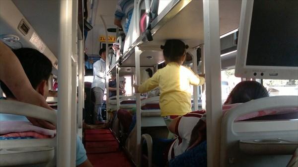 В автобусе.