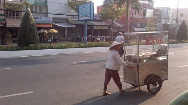 Уличные торговцы в Камау.