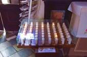 Автомат в церкви: брось 50 центов в щель - поставь свечку