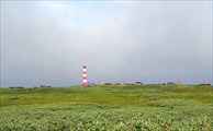 Фото. 37. Полосатый маяк Цып-Наволока. За ним надвигается туман