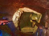 В пещере-бомбоубежище. В этой даже несколько входов-выходов.