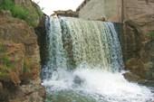 Её запрудили и получился пруд и водопад