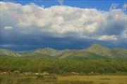 Фото 23. Вид на хребет левого берега реки Томпуды